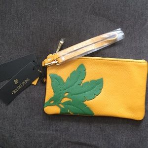 Ora Delphine mustard wristlet